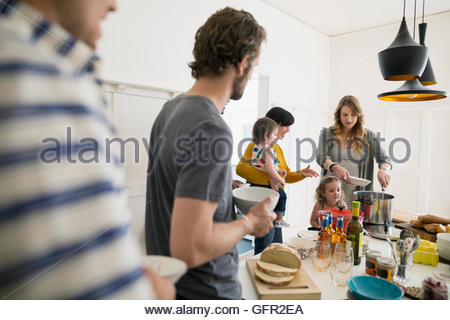 Families enjoying lunch buffet in dining room - Stock Photo