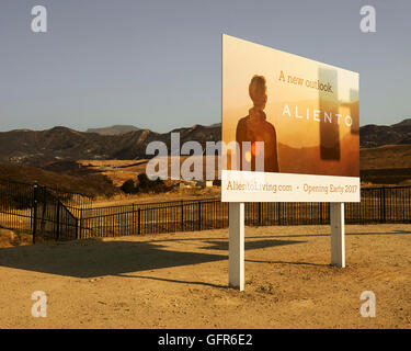 Aliento development sign overlooking the aftermath of the Sand Fire in Santa Clarita, California. - Stock Photo