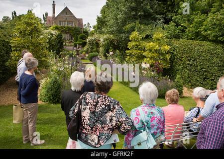 UK, England, Bedfordshire, Stevington, Kathy Brown's garden, visitors in terrace garden - Stock Photo