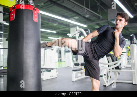 Male boxer practicing at gym - Stock Photo