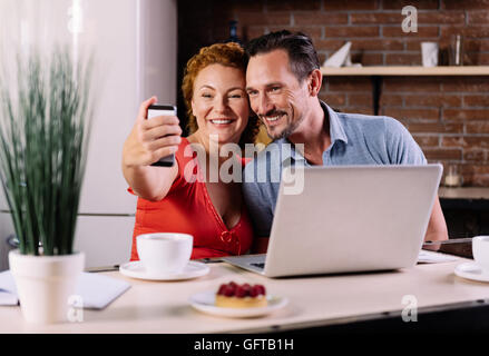 Man and woman taking selfie - Stock Photo