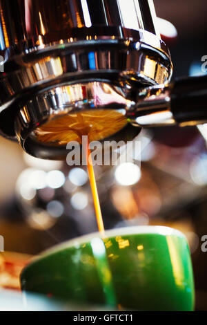 Freshly brewed coffee flowing into a coffee cup - Stock Photo