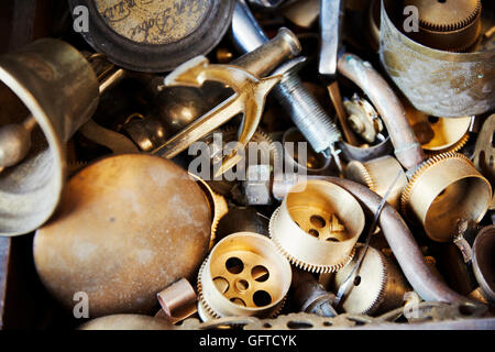 Various clock parts within a clock maker's workshop. - Stock Photo