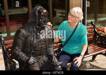 UK, England, Northamptonshire, Northampton, Guildhall, woman tourist with statue of Peasant's Poet John Clare by - Stock Photo