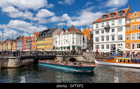 Excursion boat, Nyhavn canal, Copenhagen, Denmark - Stock Photo