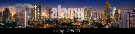 City of Bangkok, Sukhumvit skyline night shot panorama - Stock Photo