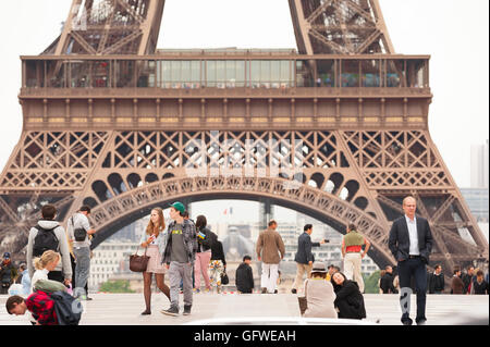 Paris Trocadero, tourists walking on the terrace of the Trocadero overlooking the Eiffel Tower in Paris, France. - Stock Photo
