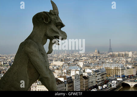 A photograph of the Galerie des Chimeres on the top of the Notre Dame  cathedral in Paris - Stock Photo