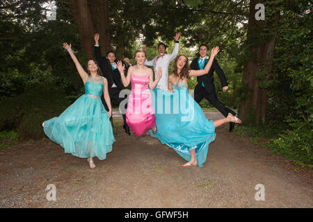 A group of friends on their way to their princess themed high school senior prom. - Stock Photo