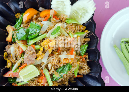 Fried rice with tomato, pork and vegetables - famous street rice food - Stock Photo