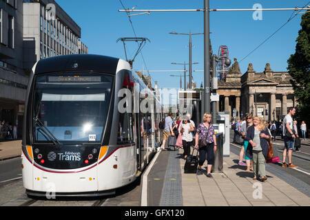 Modern tram at stop on Princes Street in Edinburgh Scotland united Kingdom - Stock Photo