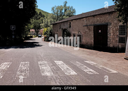 Quiet road through village of Grezels in Lot Region of France July 2016 - Stock Photo