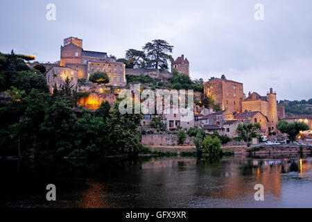 Puy L'Eveque lit up at night on banks of Lot River of South West France July 2016 - Stock Photo