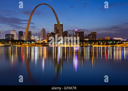 City of St. Louis skyline. Image of St. Louis downtown with Gateway Arch at twilight. - Stock Photo