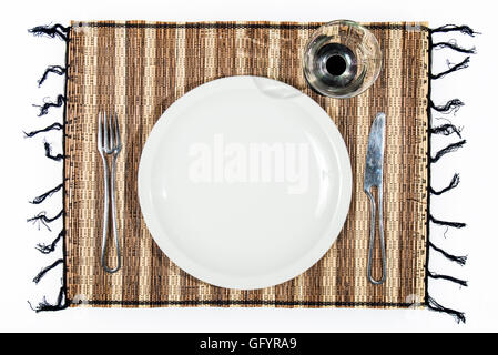 plate, cutlery and cup on a single bamboo isolated on white background. Ideal for add food or text - Stock Photo