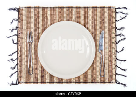 plate and cutlery on a single bamboo isolated on white background. Ideal for add food or text - Stock Photo