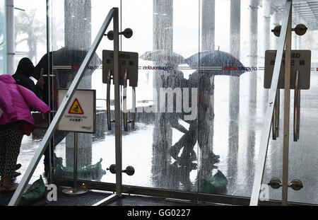 Hong Kong, China. 2nd Aug, 2016. Glass doors are reinforced to cope with strong wind brought by Typhoon Nida in - Stock Photo