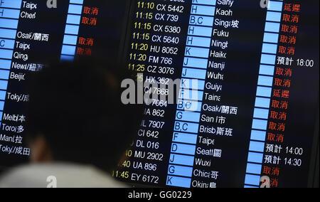 Hong Kong, China. 2nd Aug, 2016. A person looks at flight information at Hong Kong International Airport in Hong - Stock Photo