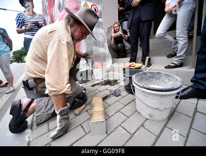 German artist Guenter Demnig, the author of the Stolpersteine (stumbling blocks) project in memory of Holocaust - Stock Photo