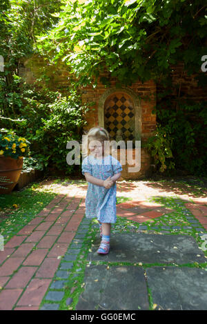 Greyfriars' House and Gardens with child / kids / kid running & playing in part of the garden. Friar St, Worcester. UK