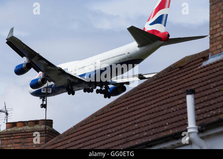 British Airways Boeing 747 ( G-BYGF Boeing 747-436) plane making final approach / landing at London Heathrow airport. - Stock Photo