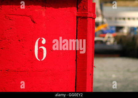 Number 6 on a beach hut - Stock Photo