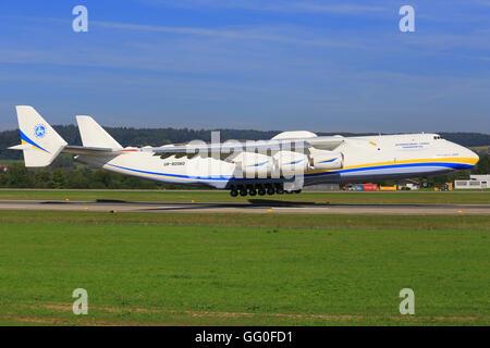 Zurich/Switzerland August 10, 2014: the biggest Airplane Antonov 225 from Antonov Airlines company landing at Zurich - Stock Photo