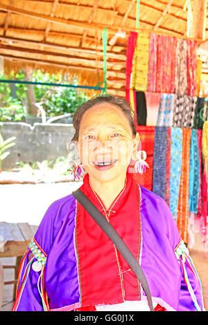 MAE HONG SON, THAILAND - JUNE 17, 2014: Unidentified Padaung (Karen) tribe woman  in traditional costume near Mae - Stock Photo
