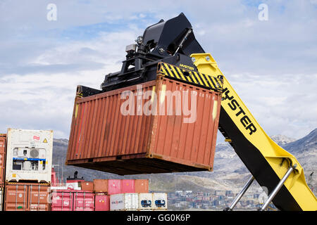 Hydraulic Hyster forklift truck lifting freight shipping containers in port. Atlantic Harbour, Nuuk Sermersooq West Greenland