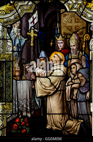Stained glass church window featuring St. Anthony of Padua. - Stock Photo