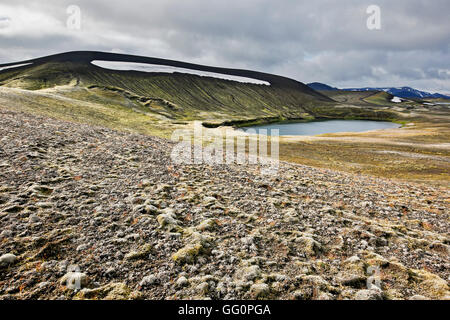 Mountain ridge, lake and lava field covered in moss, Veidivotn, Iceland - Stock Photo