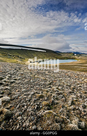 Mountain ridge, lake and lava field covered in moss, Veidivotn, Iceland - Stock Photo