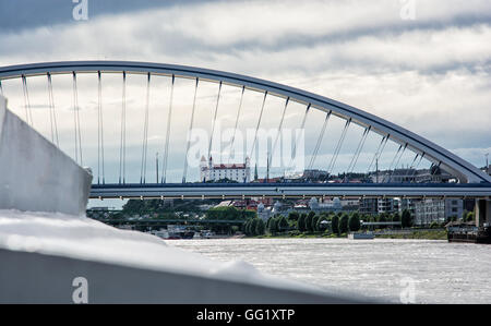 Bratislava castle behind modern Apollo bridge. Cruise on the Danube river. Ship transportation. Architectural theme. - Stock Photo