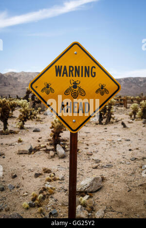 Warning sign, Cholla Cactus Garden in Joshua Tree National Park, California, USA - Stock Photo