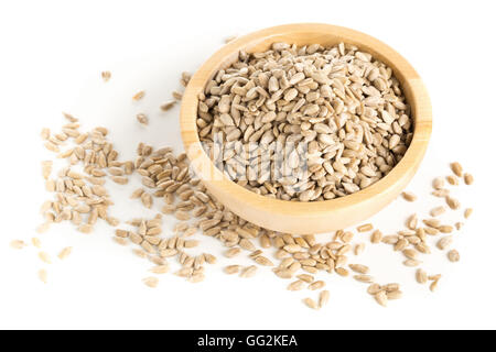 Natural shelled sunflower seeds in wooden bowl over white background - Stock Photo