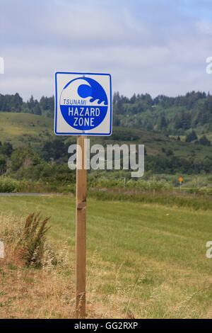 Tsunami hazard warning sign on roadside in northern California USA - Stock Photo