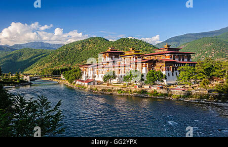 Punakha Dzong, Fortress of Bhutan, confluence of two flowing blue river and backdrop of green Himalayan mountains, - Stock Photo
