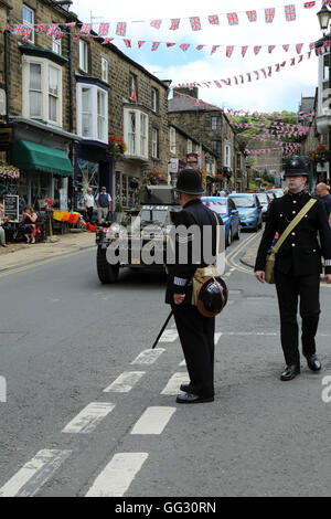 Armoured car and policemen as part of the 1940s weekend in High Street, Pateley Bridge, North Yorkshire, England, United Kingdom