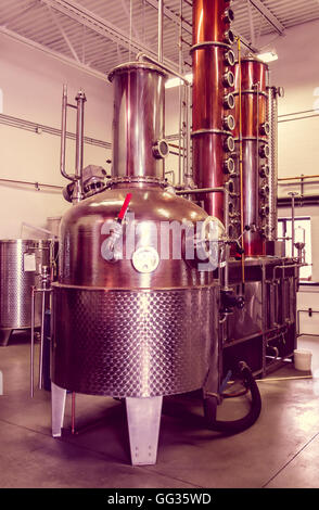 Microbrewery distillery still used to make vodka and whiskey, with vintage effect - Stock Photo
