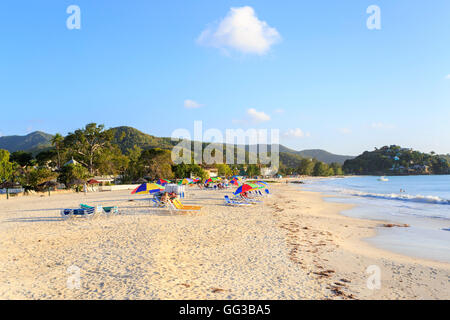 Golden sand beach at Jolly Harbour, south-west Antigua on a sunny day with blue sky - Stock Photo