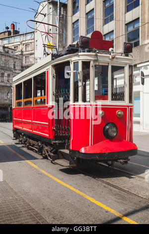 Old red tram goes on Istiklal street to Taksim square in Istanbul, popular tourist transport