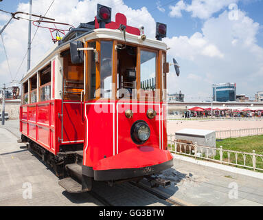 Old red tram goes on Taksim square in Istanbul, popular tourist transport