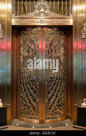 The peacock doors at the Palmer House in Chicago, designed by Louis C Tiffany on the Monroe street entrance. - Stock Photo