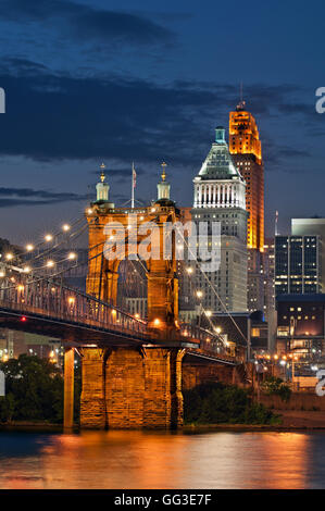 Cincinnati bridge and sky line at night. Image of Cincinnati cityscape at night. - Stock Photo