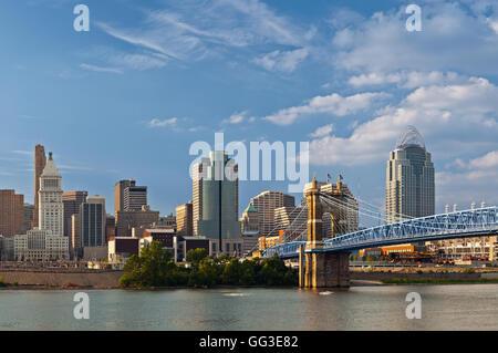 Image of Cincinnati skyline and historic John A. Roebling suspension bridge cross Ohio River. - Stock Photo