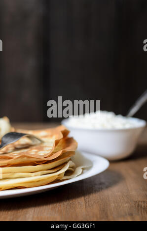 homemade pancakes on a white plate with cottage cheese - Stock Photo