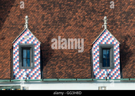 A coloured glazed tiled roof on the Old Town Hall in Bratislava old town, Bratislava in Slovakia. - Stock Photo