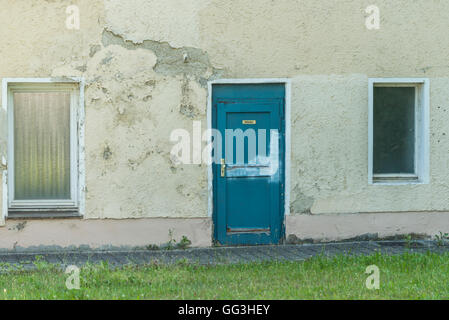 A old house with an door with german word for kitchen - Stock Photo