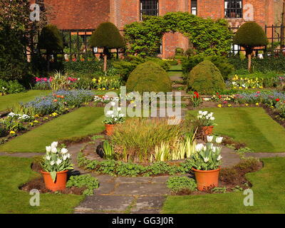 Chenies Manor House tulip borders, sunken garden and lawn on the south west side of the building;pots around the - Stock Photo