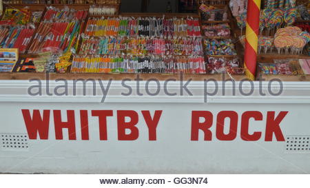 Traditional rock candy sticks on sale on a stall in the seaside town of Whitby, North Yorkshire, UK. - Stock Photo